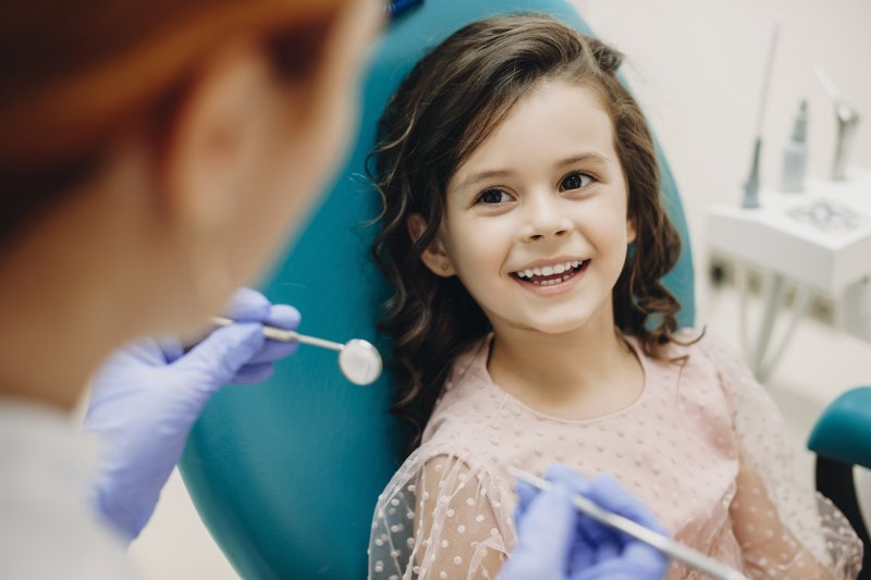 Child smiling at family dentist