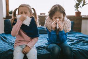 Little girls sneezing during cold and flu season