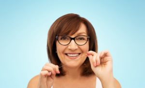 woman flossing to prevent dental emergencies in Parsippany