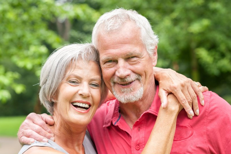 couple smile with dental implants in Parsippany
